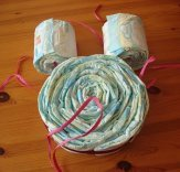 1 big roll of diapers (owls body) and 2 smaller rolls (owl's eyes) - ribbons hanging out