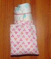 rolled diaper and how to fix the washcloth around it, folded up