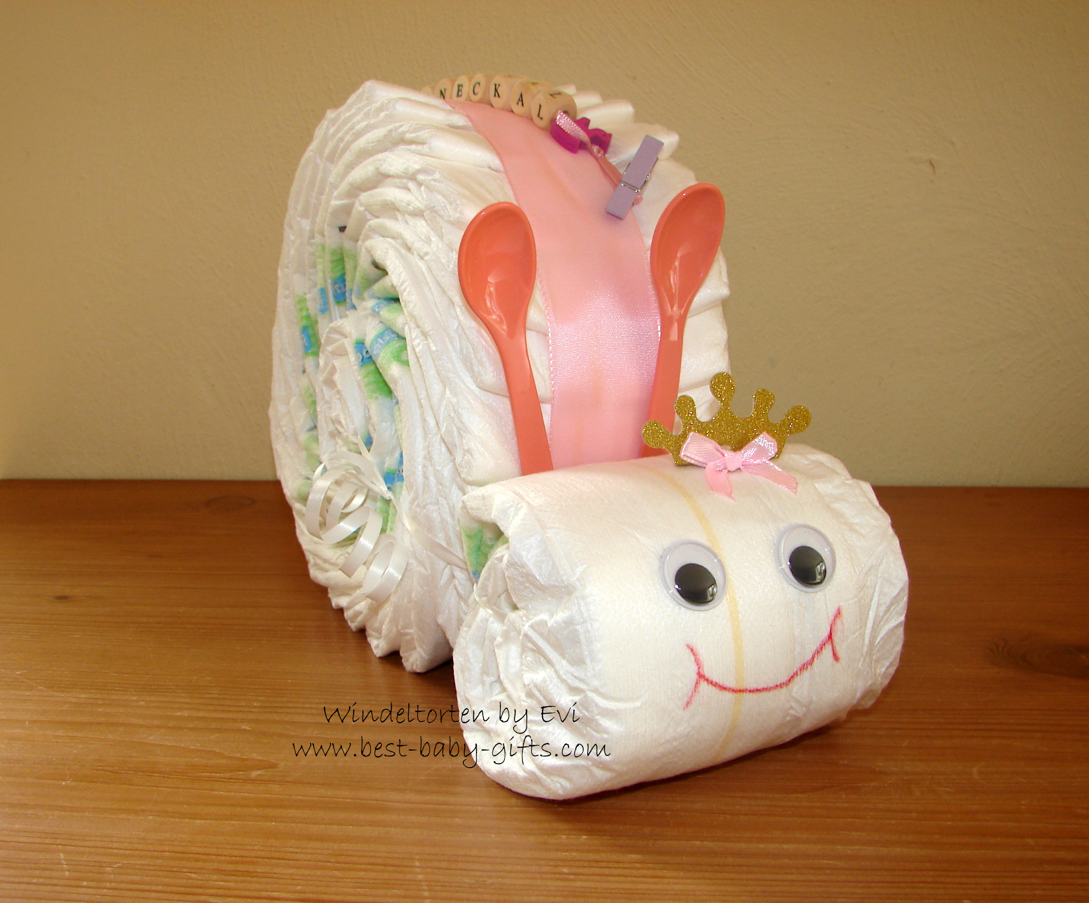 a pink diaper snail for a girl with a wooden letter chain for personalization