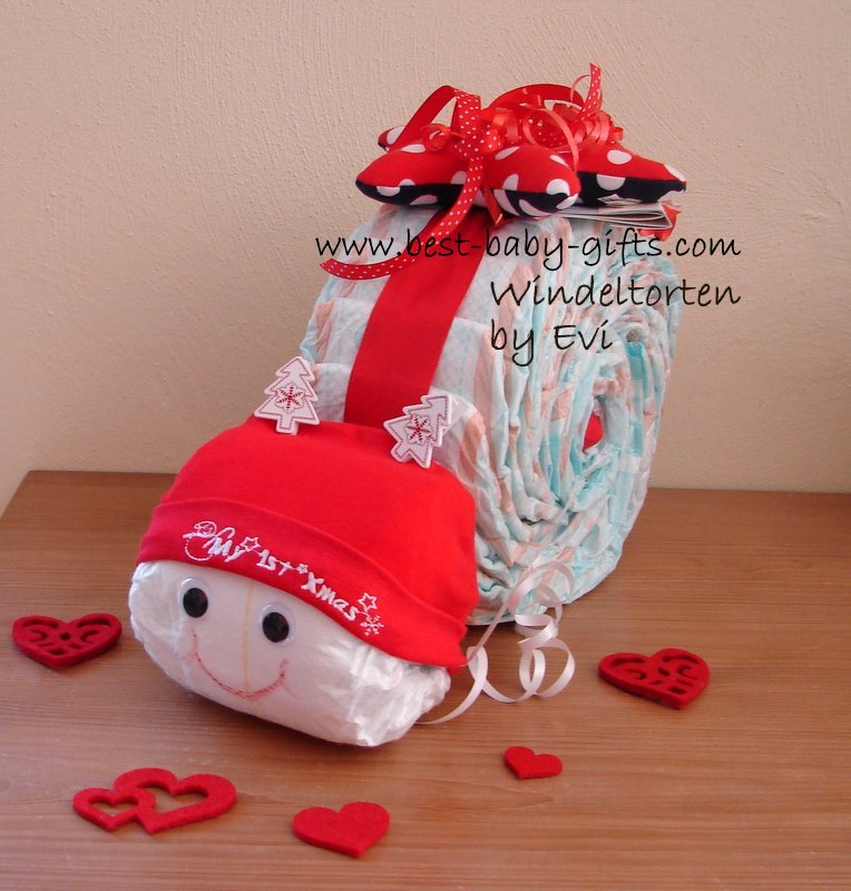 a diaper snail in red wearing a Christmas hat saying 'My 1st Xmas'