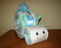 a boy diaper snail in green/blue pastel with a name chain on top