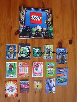 a lego brochure and lots of collector cards and trading cards, all laid out