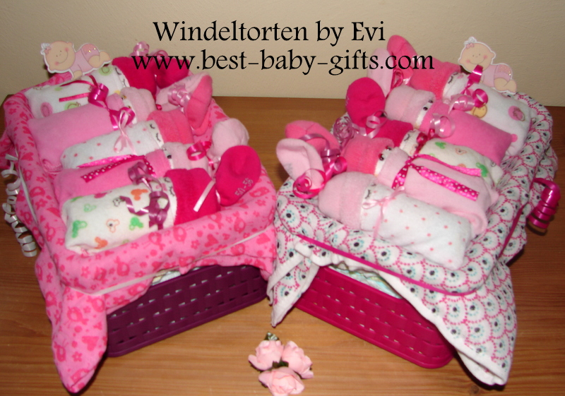 two gift baskets with diaper babies for twins, both in pink