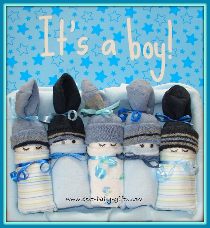 5 homemade diaper babies for boys in blue shades, placed side by side and text on top: it's a boy!