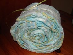 finished snail shell, lots of rolled diapers, with inner all filled up with diapers, the green ribbon to hold the diapers is clearly visible