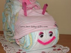 snail with a baby hat with white and pink stripes and with a big pink pipe cleaner mouth