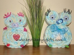 2 DIY diaper owls side by side, one in pink and one in blue
