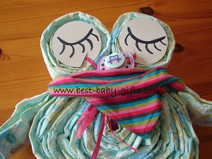 owl with sleeping eyes and baby scarf wrapped around the neck