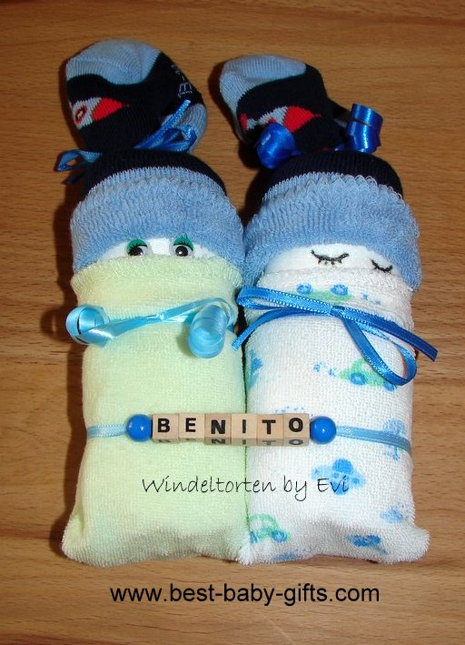 diaper babies in blue and green with a name ribbon reading 'Benito'