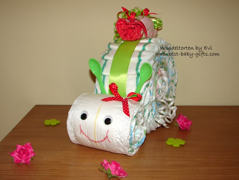 diaper snail in green and red, green baby spoons as feelers