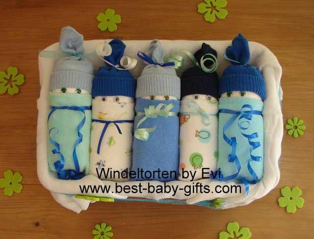 5 blue homemade diaper babies placed side by side in a box