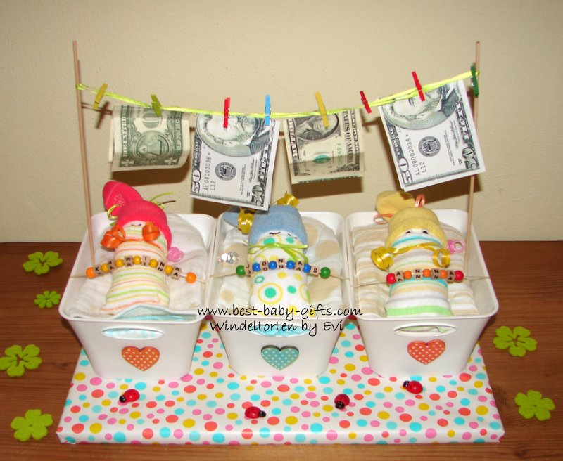 gift for triplets, 3 diaper babies sleeping in a cot (boxes) with washing clothes over the 3 cots, dollar bills attached with little clothes pegs as 'washing'