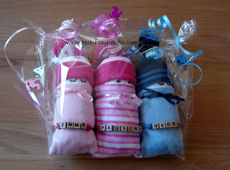 triplets baby gift: 3 little babies made of diapers (rolled diaper with a sock hat and a wash cloth as a blanket), personalized with the babies names