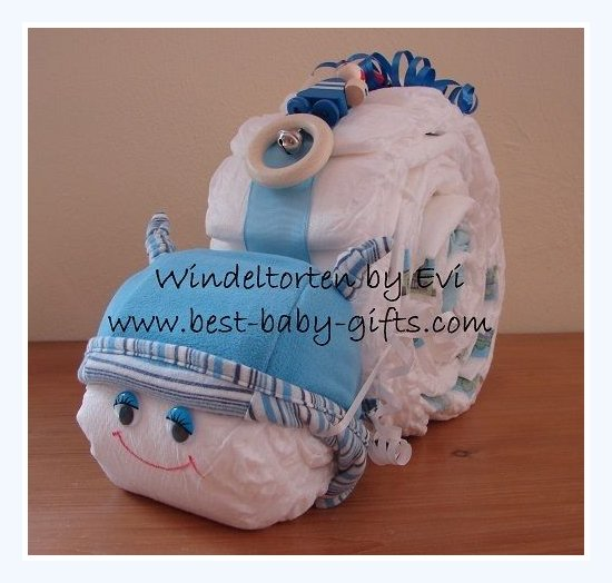 homemade boy diaper snail with baby hat and wooden toy