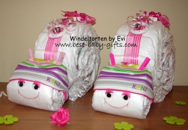 2 identical diaper snails side by side, they have rainbow color accessories such as the striped baby hats they are wearing and they are very colorful
