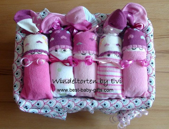 5 girl diaper babies in pink, rose and white in a box