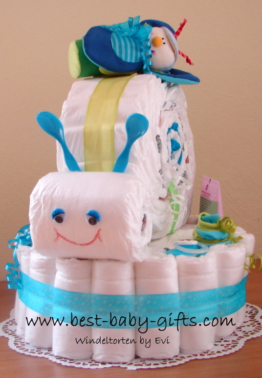 diaper base with a diaper snail on top, main colors are blue and turquoise, a bettle rattle is on top