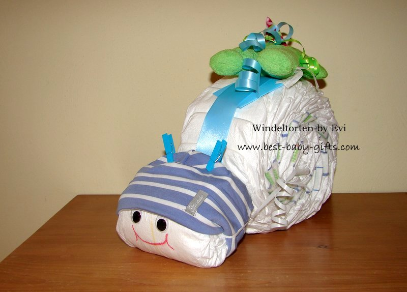 diaper snail with blue hat and cuddly frog on top