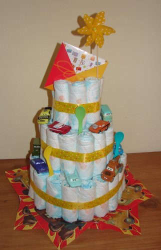a large diaper cake decorated with various Cars characters, main colors yellow, blue and red