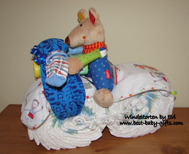 motorcycle diaper cake with a cuddly mouse being the driver, mainly blue colors, side view