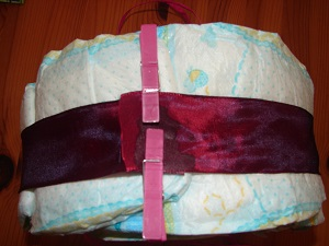 dark red ribbon fixed around the diapers