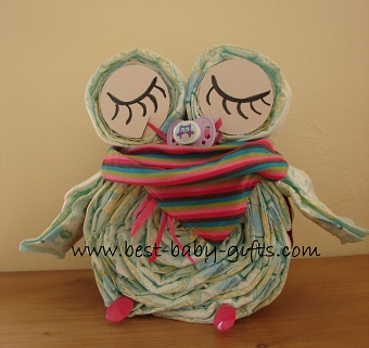 sleeping diaper owl in girl colors with colorful baby scarf