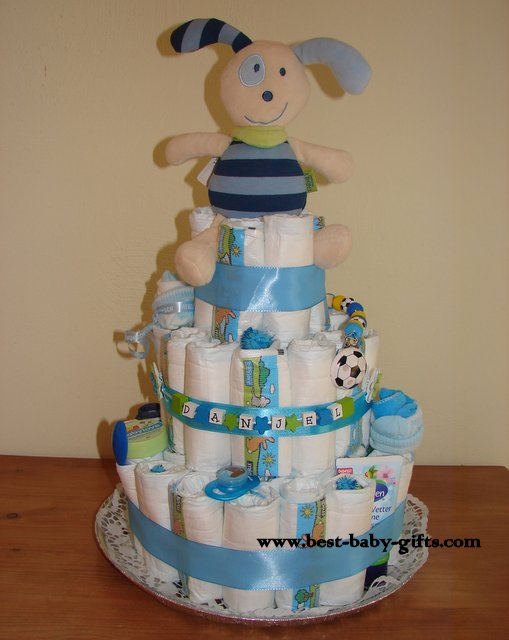 large boys diaper cake in light blue with a cuddly puppy on top