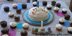 lots of yummy cupcakes circled around a birthday cake with 1 candle