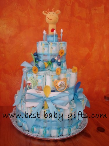 3-tier diaper cake in blue and yellow with a cute giraffe rattle on top, sticking out of the cake