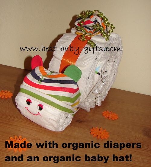 diaper snail with a colorful hat and text saying: made with organic diapers and an organic baby hat!