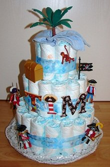 3 tier diaper cake with pirate decoration (pirate figurines, palm, treasure chest, parrot, pirate flag, monkey...), personalized with big letters TIM